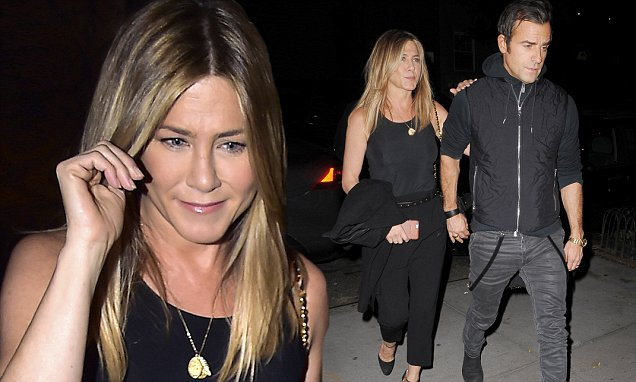 Can't Hide Her Grin: Jennifer Aniston Holds Tight On Husband