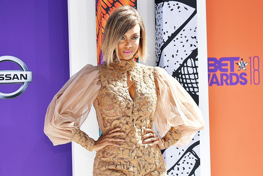 Tyra Banks Wears SEE-THROUGH Gold Outfit to BET Awards!